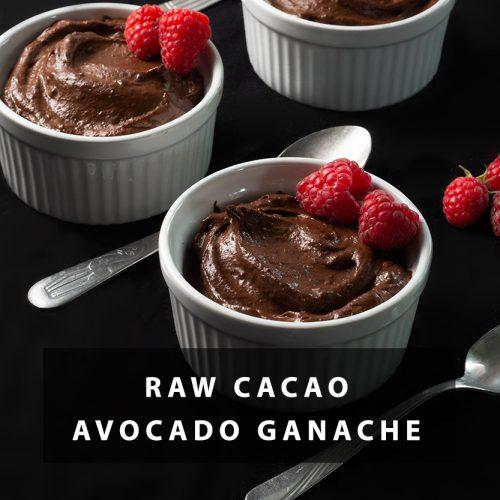 Raw Cacao Avocado Ganache in Ramekins with spoons and rasperries